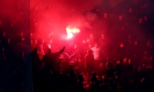 Chelsea fans let off a flare during Tuesday's match in Paris.