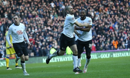 Jake Buxton and Darren Bent celebrate after the former's second equaliser against Sheffield Wednesday.