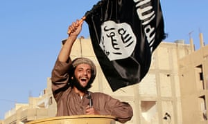 An Islamic State fighter waves the Isis flag in Raqqa, Syria
