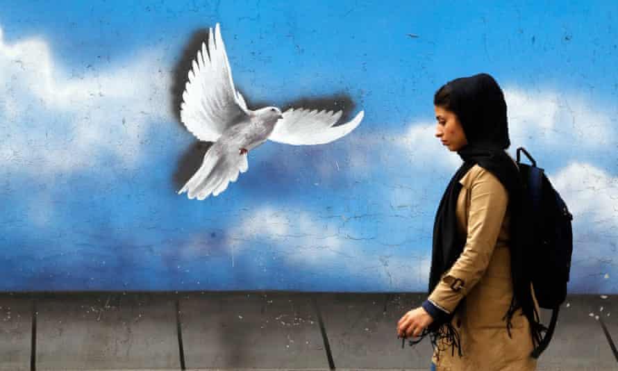 An Iranian woman walks down a street in Tehran, Iran.