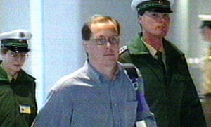 Nick Leeson is escorted by officials at Frankfurt airport after an international manhunt tracked him down in 1995