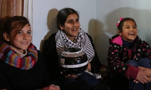 Malak al-Khatib, centre, with two friends the day after she was released from Israeli prison.