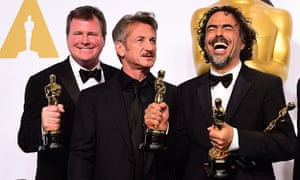 (left to right) Producer James W. Skotchdopole, Sean Penn and producer/director Alejandro G Inarritu backstage at the Oscars.