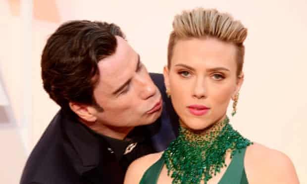 The face of this year's Oscars … John Travolta and Scarlett Johansson