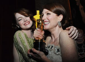 Nominee for Best Supporting Actress Emma Stone and winner of Best Actress Julianne Moore at the Governor's Ball