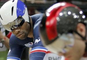 Grégory Baugé of France, left, competes with Denis Dmitriev during the men's sprint.