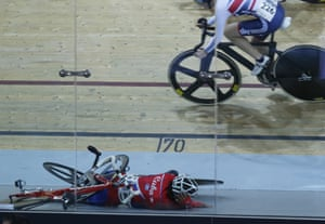 Yumari Gonzalez Valdivieso of Cuba falls down after colliding with another cyclist during the final of the women's scratch 10km race.