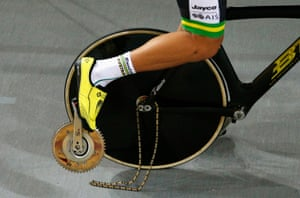 Luke Davidson of Australia rides with his pedal and crank broken in the men's team pursuit qualifying.