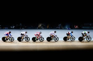 Riders including Matthew Glaetzer of Australia, Joeseph Veloce of Canada and Stefan Boetticher of Germany compete in the men's keirin first round race.