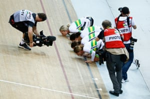 <strong>Day 2:</strong> Annette Edmondson, Ashlee Ankundioff, Amy Cure and Melissa Hoskins of Australia kiss the track after winning the gold medal in a new world record time in the women's team pursuit final.