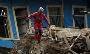 A rescue worker searches for survivors in Constitución.