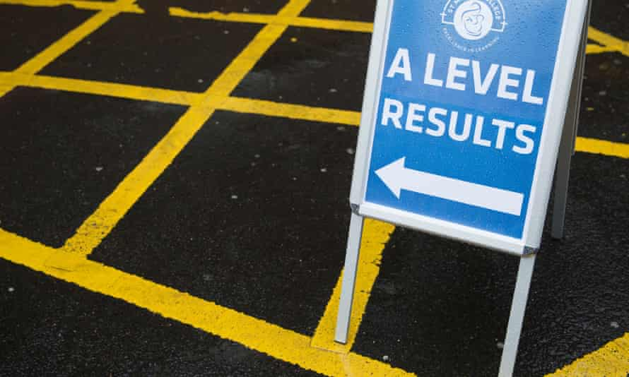 Students receiving their A-level results at St Mary's College in Blackburn, Lancashire.