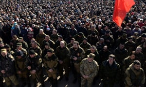 Pro-Russian separatists of the self-proclaimed DPR attend the rally Defenders of the Fatherland day.