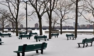 There is an absence of people in this empty park in winter by the Charles River in Boston