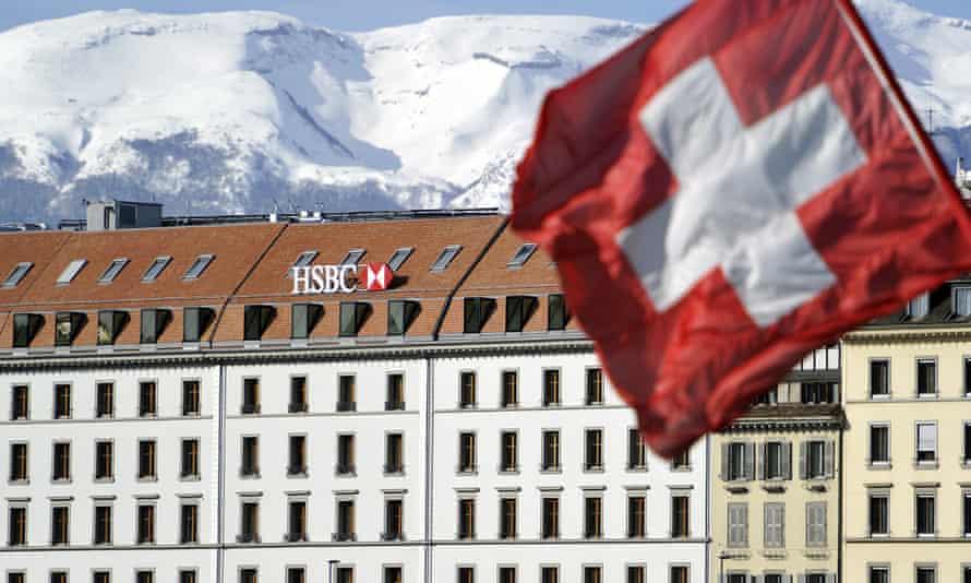 A Swiss flag flies above a HSBC logo.