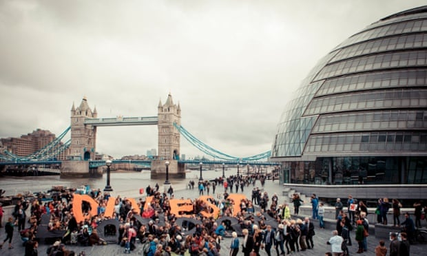 People gathered outside City Hall, London, as part of global day of action against fossil fuels, Saturday February 14, 2015.