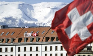 A Swiss flag flies above HSBC offices in Geneva