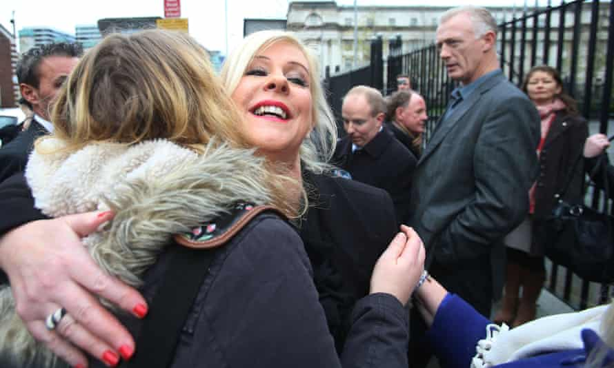 Bernadette Smyth leaves Belfast magistrates court after she was given a five-year order banning her from the vicinity of the clinic for harassing the clinic's director.
