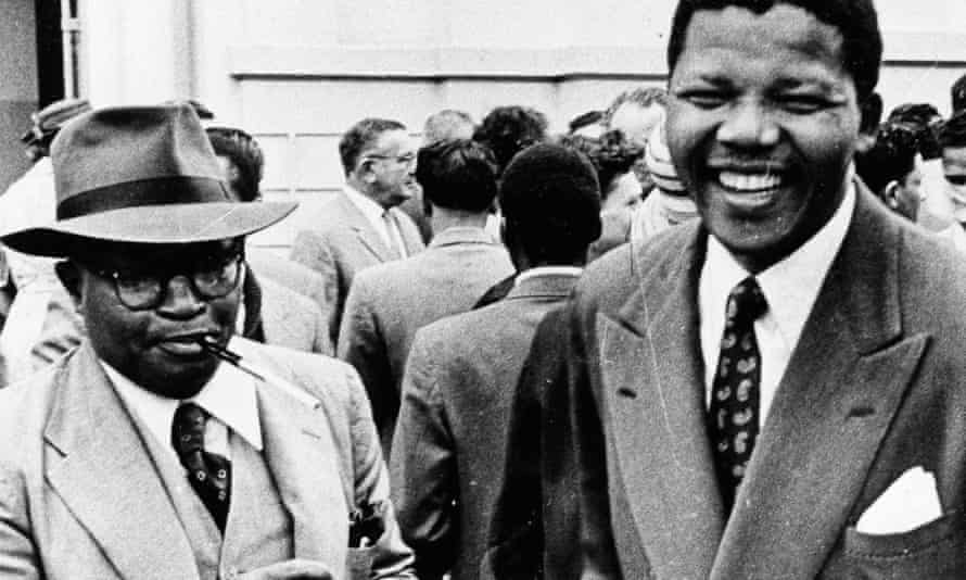 Moses Kotane (left) emerges from court in Pretoria with Nelson Mandela at the end of the first day of their treason trial October 1958