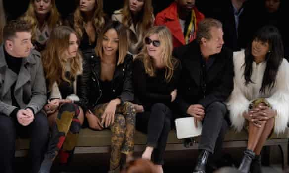 From left: Sam Smith, Cara Delevingne, Jourdan Dunn, Kate Moss, Mario Testino and Naomi Campbell at the Burberry show.