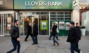 Pedestrians walk past a branch of Lloyds. The banking group was the most complained-about business during the second half of 2014.