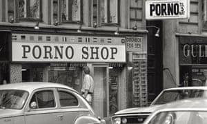 A man observes the window of a porn shop in Copenhagen in 1969.