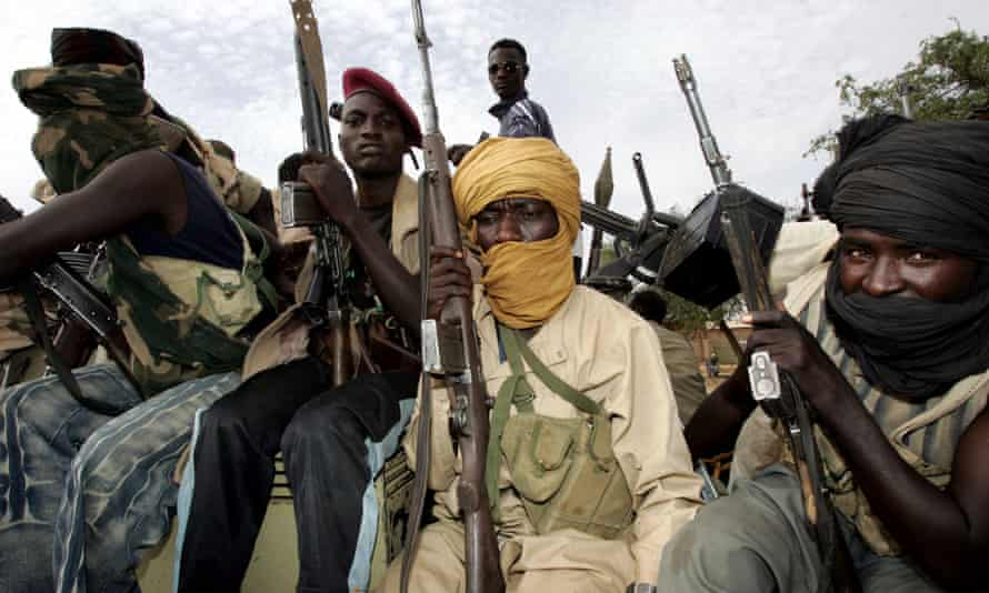 Rebels loyal to leader Minni Minnawi ride into El-Fasher, the administrative capital of north Darfur.