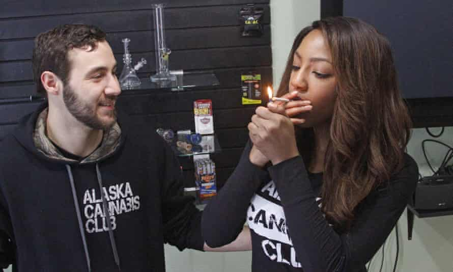 Peter Lomonaco and Charlo Greene share a joint
