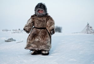 On the Tundra.: a Young Nenets boy plays in -40 degrees on Yamal in the Winter in Siberia