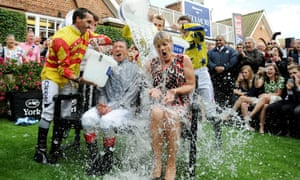 Frankie Dettori and Clare Balding take part in the Ice Bucket Challenge during the 2014 Welcome To Yorkshire Ebor Festival at York Racecourse, York.