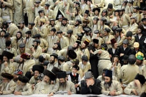 Ultra-Orthodox Jewish men from the Toldot Aharon Sect celebrate the Purim holiday in Jerusalem