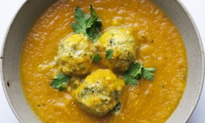Nigel Slater's recipe for carrot and cardamom soup with 3 herb ricotta dumplings in a bowl