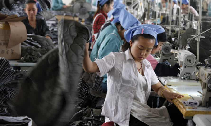 A textile worker in Huaibei, Anhui province. It is not uncommon for divorced women to lose everything and go to the cities to find work.