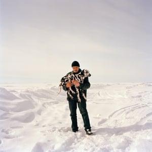 Yar-Sale, Russia. Anton and his dalmatian take a break on the Yamal peninsula
