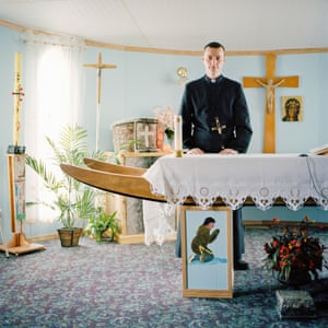Repulse Bay, Canada. Father Daniel Szwarc in the Roman Catholic mission which has an Inuit sledge altar