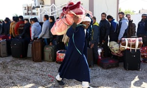 Egyptians queue up with their belongings