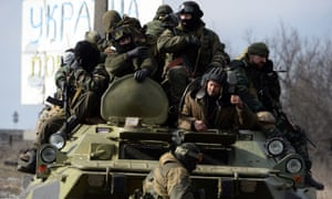 Pro-Russian rebels sit on an armoured personnel carrier in the eastern Ukrainian city of Debaltseve.