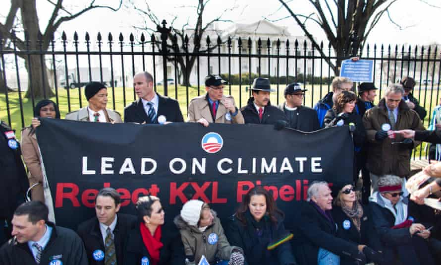 Members of the environmental groups Sierra Club, 350.org, and Committed Citizens demonstrate in front of the White House against the Keystone XL oil sands pipeline in Washington DC, USA, 13 February 2013.