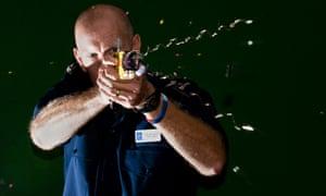 A Taser stun gun is demonstrated.