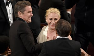 Ethan Hawke and Richard Linklater congratulate Patricia Arquette on her Oscar win.