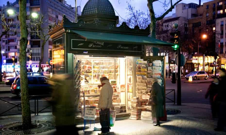Newspaper kiosk in Paris at dusk