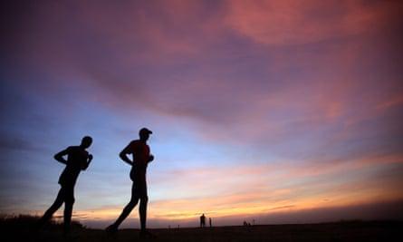 Runners on a mountain in northern Uganda