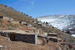 Berber men walk in the valley of Ait Sghir of the Agoudal region in the High Atlas region of Morocco