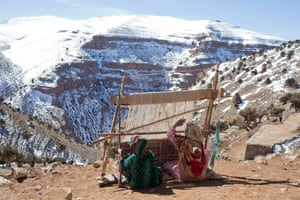 Women weave traditional carpets