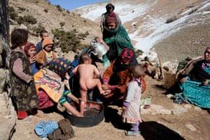 Women wash a child