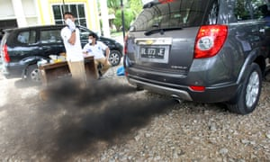 An Indonesian Environmental Impact Management Agency (BAPEDAL) employee checks the smoke from the exhaust pipes of a car on a machine, during the automobile emissions inspection in Banda Aceh, Indonesia, 04 July 2012. The Indonesian government will soon rule about Low Cost Green Car to suppress the high rate of pollution due to the increase of motorcycle and vehicles in Indonesia.
