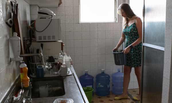 Isabela Berger Sacramento tops up her water stocks.