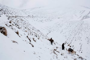Men return home after transporting food and goods on mules between villages