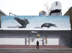 Mehdi Ghadyanloo in front of his mural in Shoreditch, London