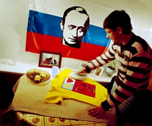 <strong>Artyom, member of the VV Putin fanclub, at home ironing his T-shirt</strong>